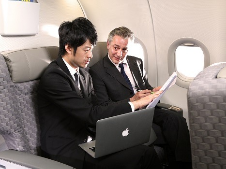 Two passengers discussing business