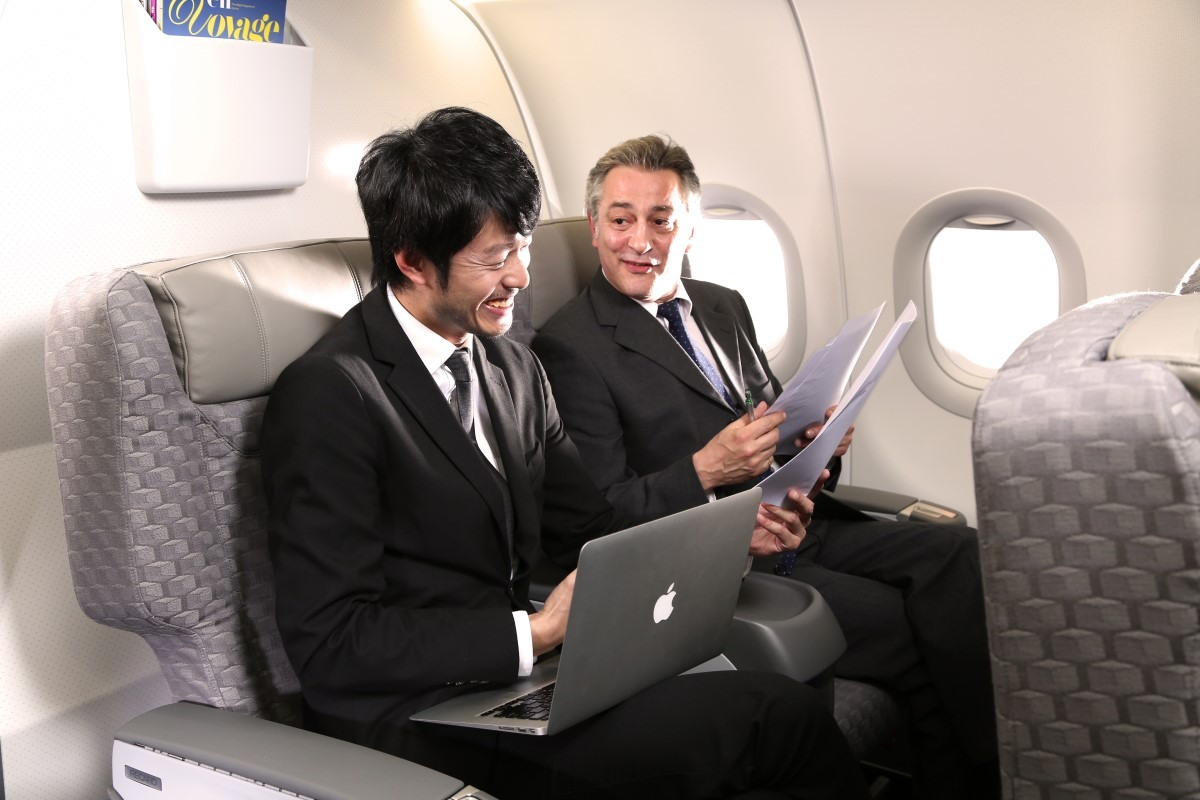 Men discussing in Business Class
