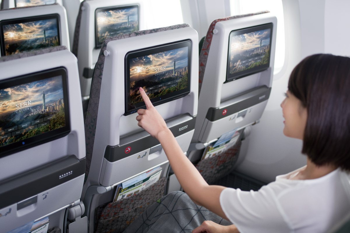 Passenger using inflight entertainment service in Economy Class