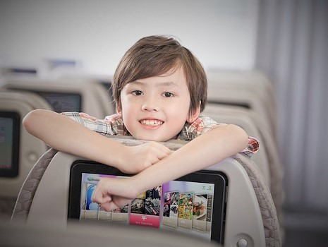 a child in an airplane seat(Premium Economy Class)