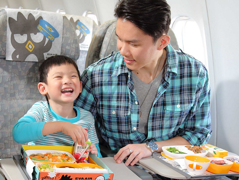 a passenger child is eating a meal