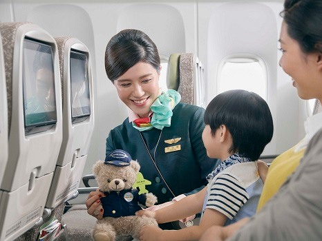 a traveler kid and cabin crew